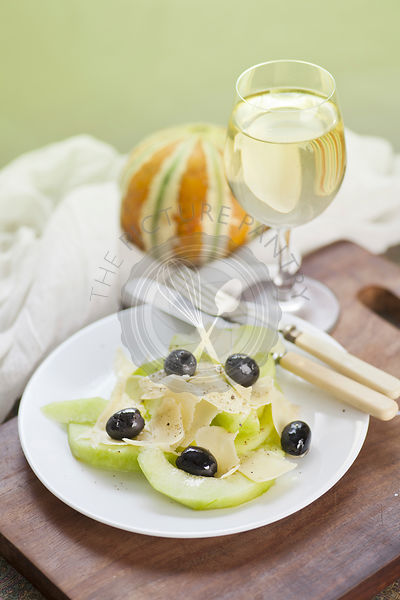 Salad Plate of sliced melon, cheese and olives