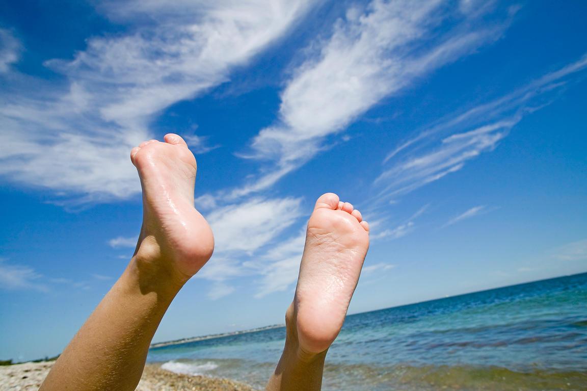 big sale 9dfcc b5c56 Feet waving in air at the beach