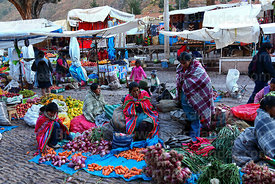 Quechua women and vegetable stall in Pisac market, Sacred Valley, Cusco Region, Peru