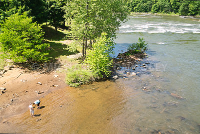 Family Enjoying Youghiogheny River Shore- Ohiopyle, PA