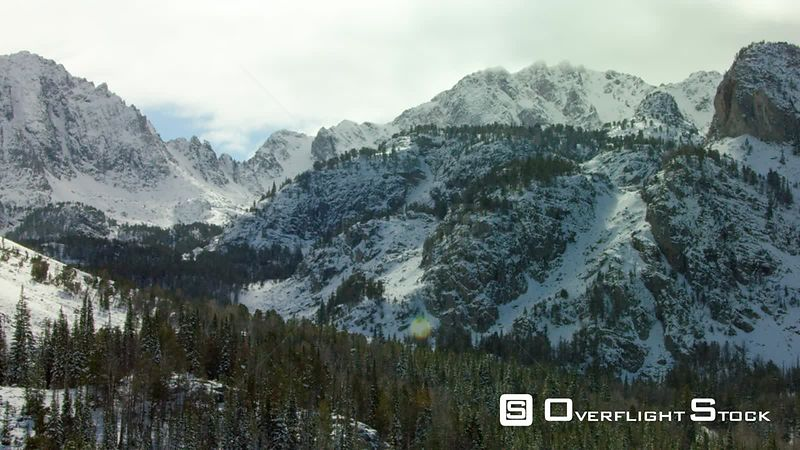 The snow covered peaks, steep cliffs and glacial valleys of the Madison mountain range in southwestern Montana