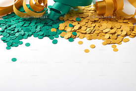 Carnival background with serpentines and green and yellow confetti