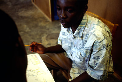Burundi - Ruyigi - A boy is treated by a trauma therapist