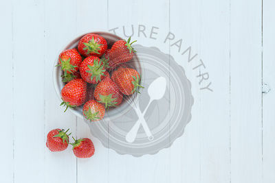 Strawberries in a pink bowl