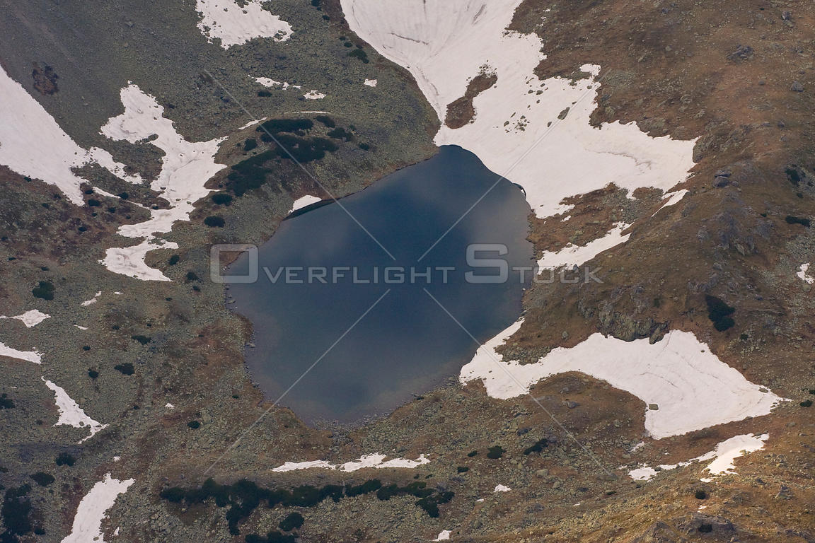 Alpine lake created by melting snow, High Tatras, Carpathian Mountains, Slovakia, June 2009