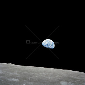 24 Dec. 1968) --- The rising Earth is about five degrees above the lunar horizon in this telephoto view taken from the Apollo...