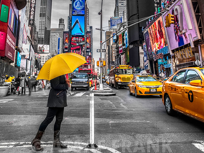 Man with yellow umbrella at Times square, New York