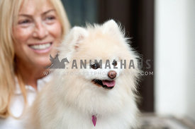Light-Pomeranian-with-Woman-in-White-Smiling