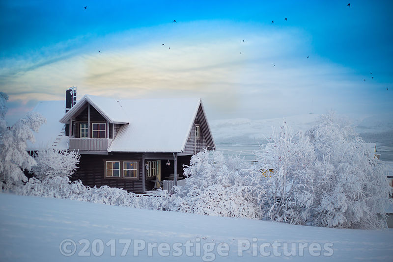 Snow covered picturesque house in the Arctic town Kirkenes