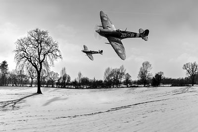 Low-flying Spitfires in winter black and white version