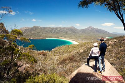 Hikers looking down to Wineglass bay, Tasmania, Australia