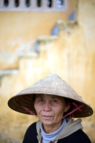 An old woman in traditional Vietnamese dress in the Gardens at the Thienmu Pagoda