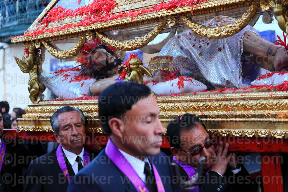 Devotees carry Santo Sepulcro / Crucified Christ during Good Friday procession , Cusco , Peru