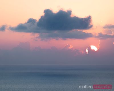 Cloud with shadow projecting on the sea, at sunrise