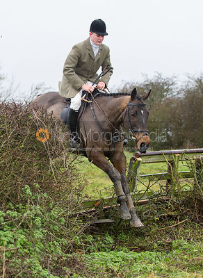 William Grant jumping near the new Jubilee Covert - Cottesmore Hunt at Deane Bank Farm 4/12/12