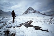Hiker standing at Buachaille etive beag Scotland UK