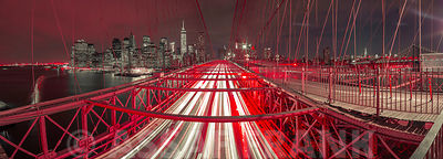 Night view of Brooklyn bridge with strip lights, New York