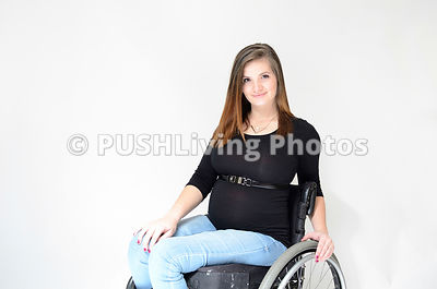 Pregnant Mom in wheelchair portrait on white