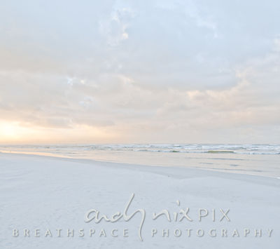 Sunrise on beach, soft pale pastel colours