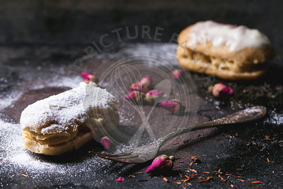 Eclairs with sugar powder