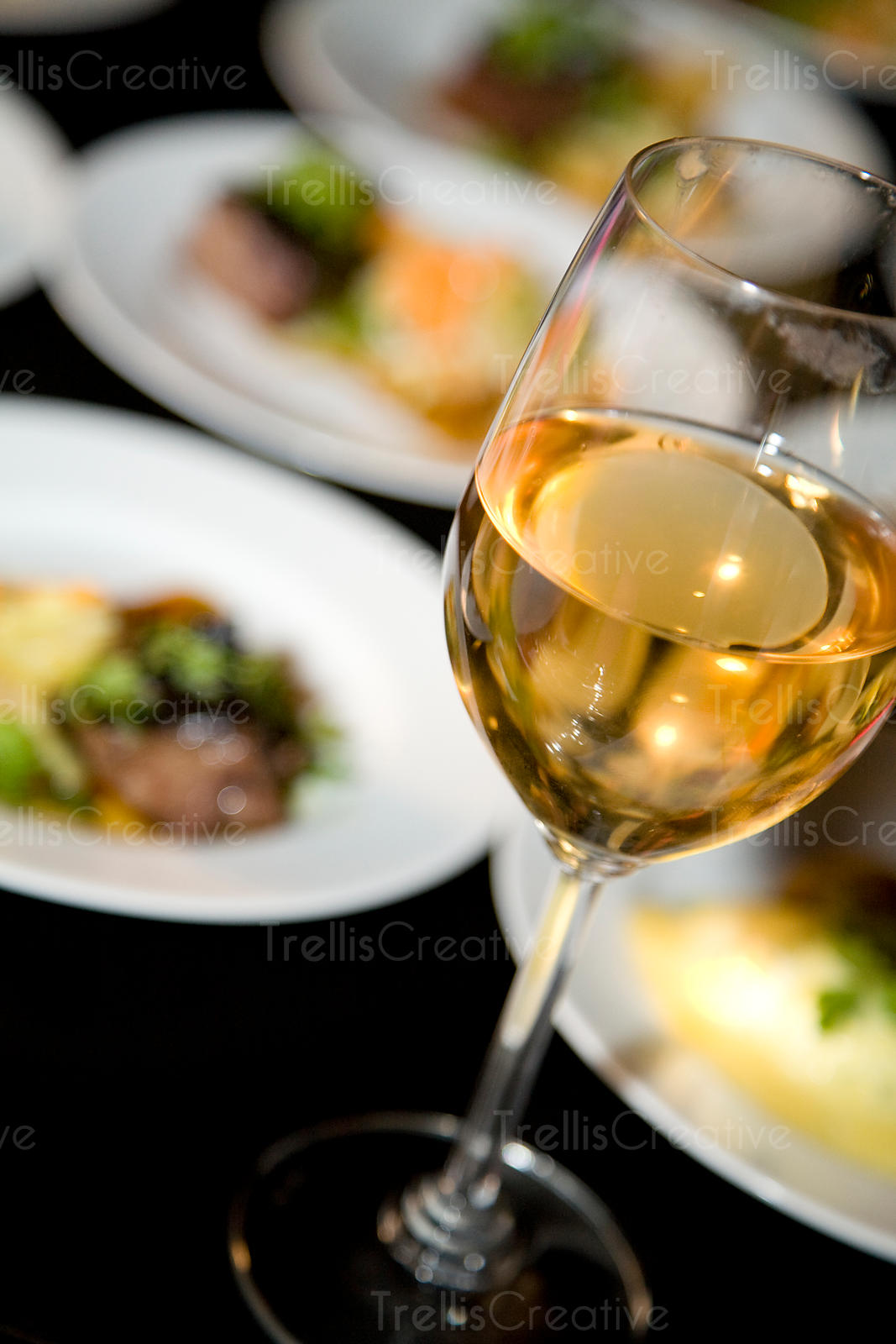 Close-up of a glass of white wine paired with red meat