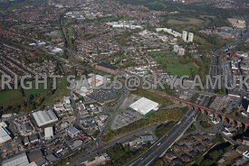 Stockport aerial photograph looking across the M60 motorway junction 1 Travis Brow B&Q and Decathlon and the surrounding indu...