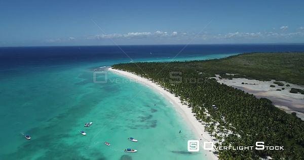 Caribbean beach and palm trees. High altitude flight forward . Saona Island, Dominican Republic