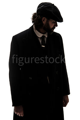 A vintage man in a peaky cap – shot from eye level.