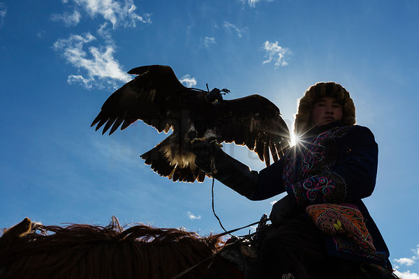 Portrait of a Young Golden Eagle Hunter with his Bird