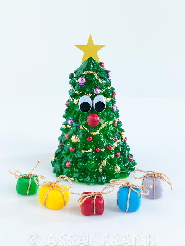 Decorated Christmas tree with gift boxes on white background