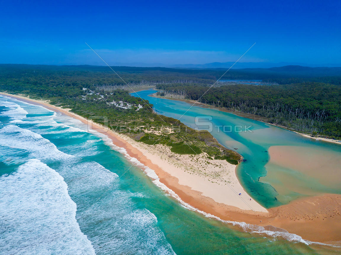 Durras lake inlet and the South Durras spit at Durras Beach on beautiful summer day. NSW Australia