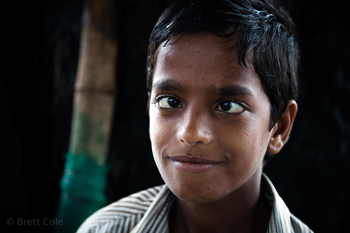 "Portrait of a ""cross-eyed"" boy on Chowpatty Beach, Mumbai, India."
