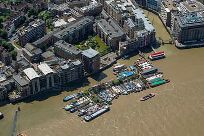 River Barges on river Thames Bermondsey London England