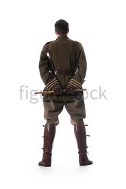 A Figurestock image of standing, first world war British officer, from behind – shot from low level.