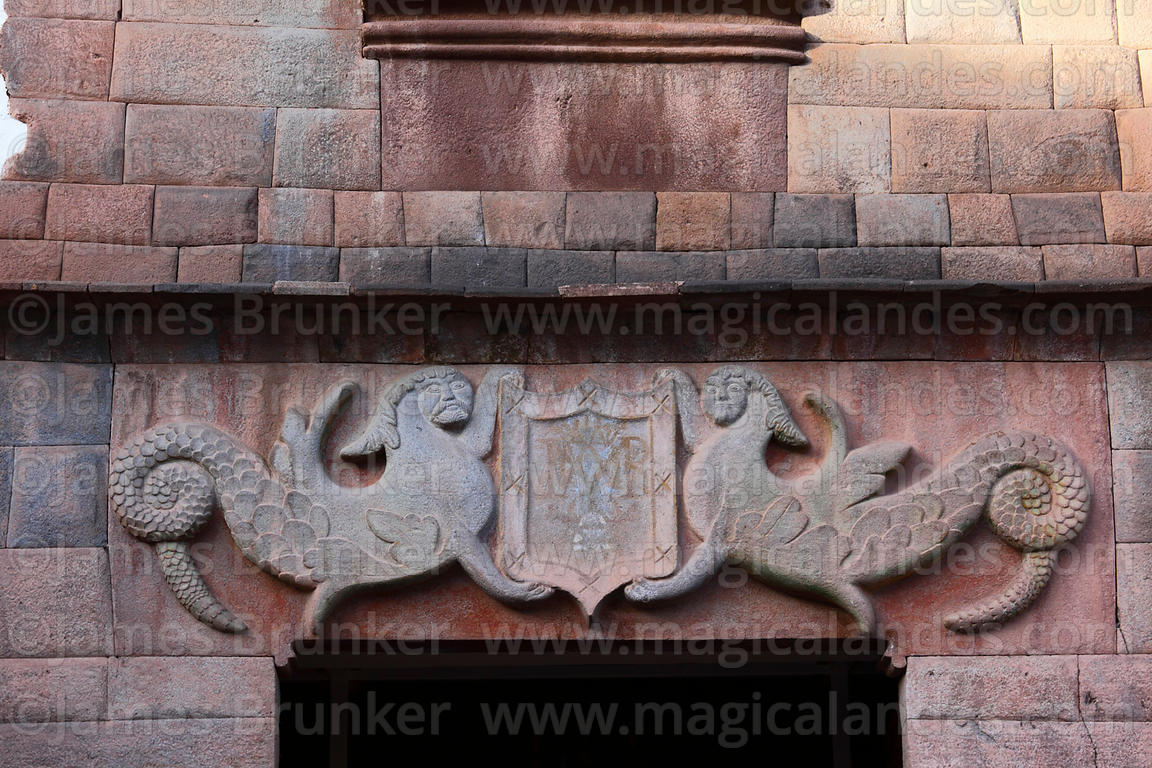 Carved stone figures above entrance of the Nazarenas Palace, Cusco, Peru