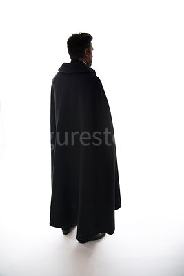 A mystery man in a cloak, in silhouette – shot from eye level.