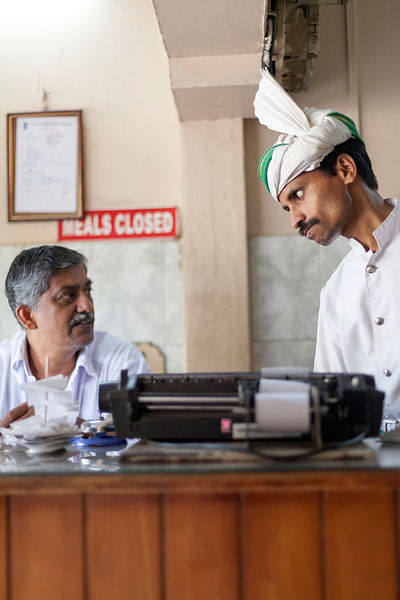India - Thelassery - The manager and a waiter at the Indian Coffee House