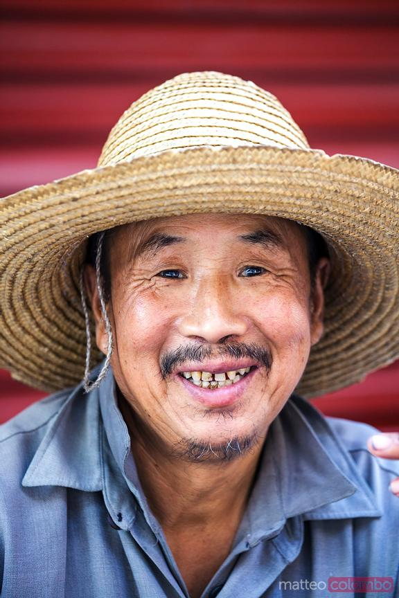 Portrait of chiense farmer in the muslim quarter of Xian, China