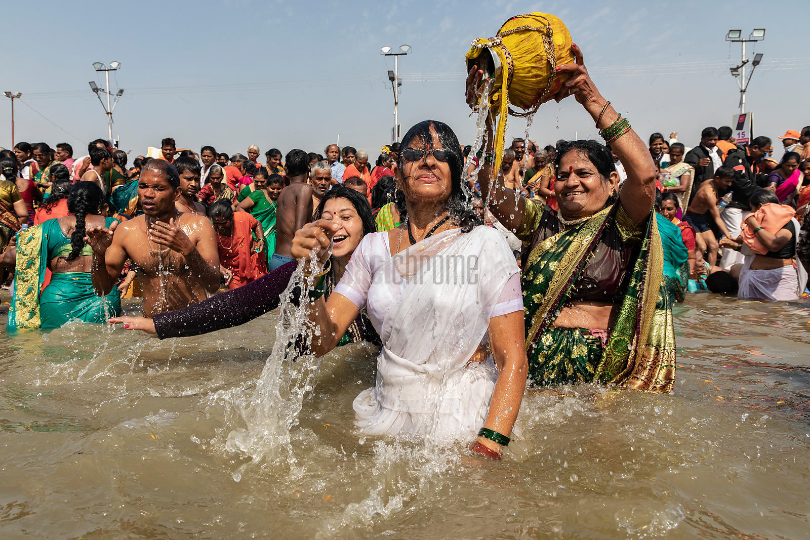 Pilgrims Revel in Bathing in the Ganges at the Sangam