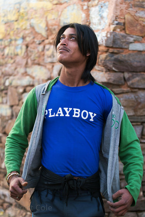 "Man in a ""Playboy"" shirt strikes a pose at Taragarh, Rajasthan, India. Playboy is a popular brand in India. I've seen hundred..."