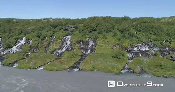 Flying Close to Hraunfoss Lava Spring Waterfall Glacial River Iceland Aerial 4k