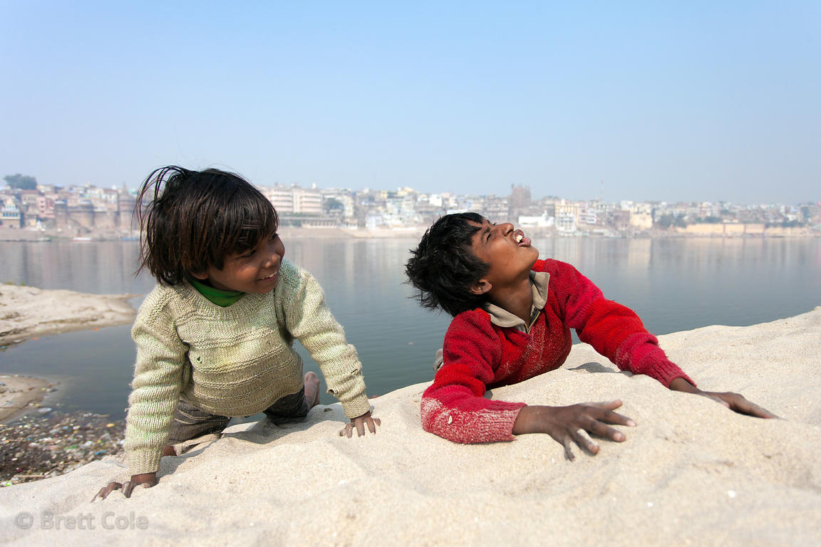 Children play on a sand dune on the banks of the Ganges River, Varanasi, India.