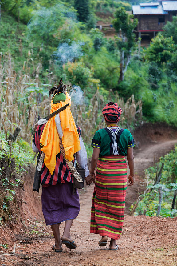 Couple in Traditional Dress Walking on Path