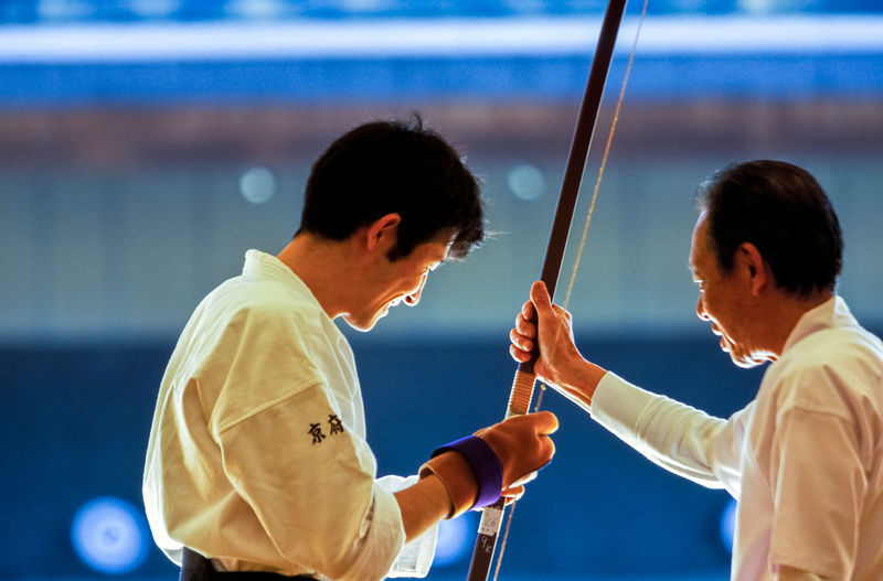 A Kyudo master gives some tuition to a pupil at the Kyoto Budo Centre, Kyoto