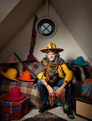 Environmental portrait of Max-A-Hatter in his studio on Johnson's Island in Brentford, UK