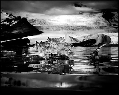 Ice floes and snowy mountains reflecting in the dark water, Iceland 2014 © Laurent Baheux