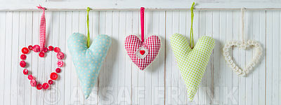 Hearts hanging on wooden background