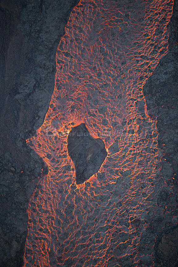 Aerial view of lava river flowing toward Kapoho, Puna District from fissure 8 of Kilauea volcano, near Pahoa, Hawaii. June 2018.