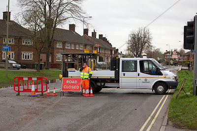Oxford County Council Worker Manning a Road Closure due to Flooding