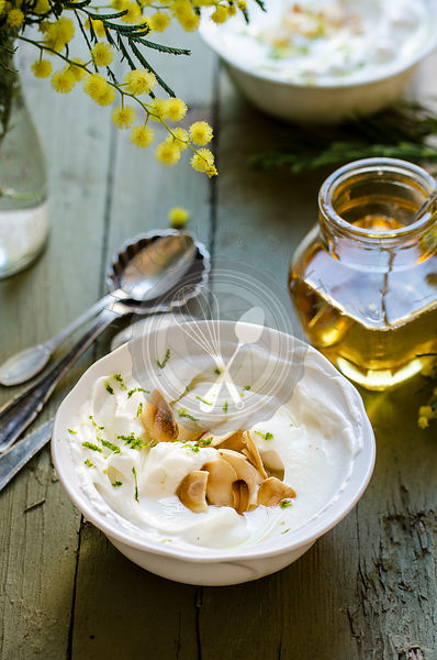 Syllabub with lime and almond flakes